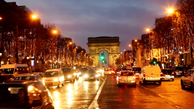 Paris City Traffic on the Champs Elysees at Night During Christmas