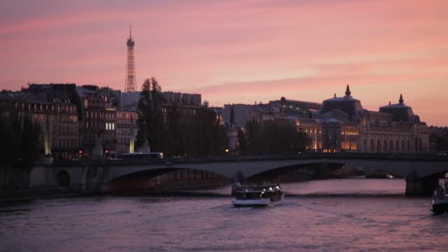paris cityscape at dusk - paris seine stock videos and b-roll footage