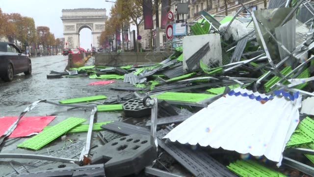 Paris cleaning crews clear out debris and clean up the Champs Elysees Sunday morning the day after a protest by anti fuel hike activists was marred...