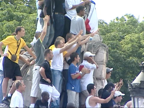 paris crowds france paris elysee palace ext crowds stand outside elysee palace and chhering as france football team arrive - 2006 stock videos & royalty-free footage