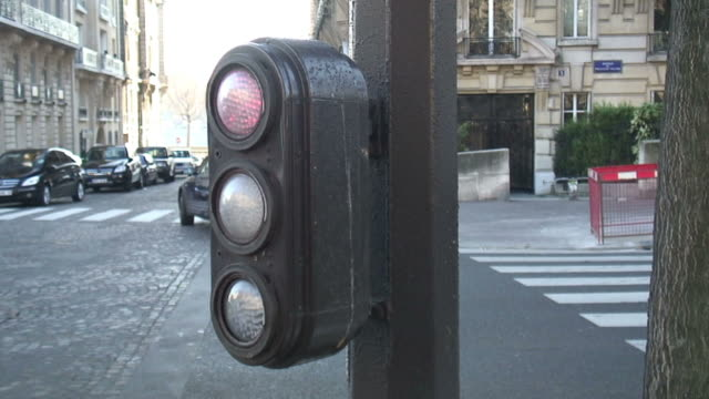 (hd1080i) paris: driver level traffic light goes red to green - green light stoplight stock videos and b-roll footage