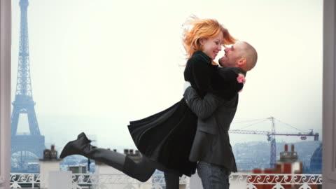 paris eiffel couple cinemagraph 4k - film montage stock videos & royalty-free footage