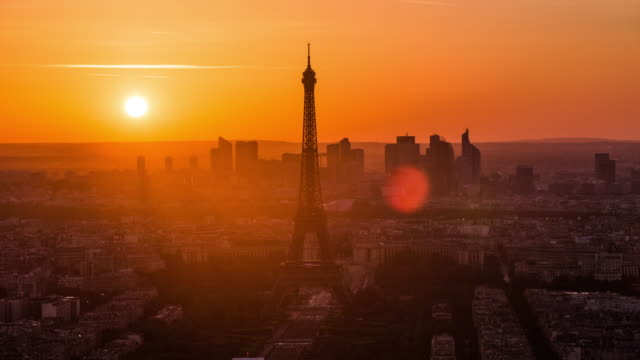 paris eiffel tower at sunset - time lapse - paris france stock videos & royalty-free footage