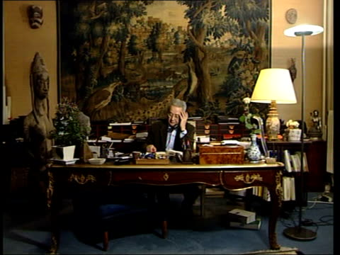 paris: ext sarah smith arriving at lawyer, jacques verges, offices int cms & jacques verges talking on phone in his office sarah smith up stairs... - weapons of mass destruction stock videos & royalty-free footage