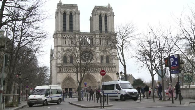 paris famous notre dame cathedral is under high surveillance ahead of the traditional christmas mass - cathedral stock videos & royalty-free footage