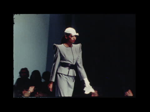 paris fashions; a) france: paris: pierre cardin evening dress model puts hat on cms model checks out coat cms one in white coat model looks in mirror... - anna ford stock videos & royalty-free footage