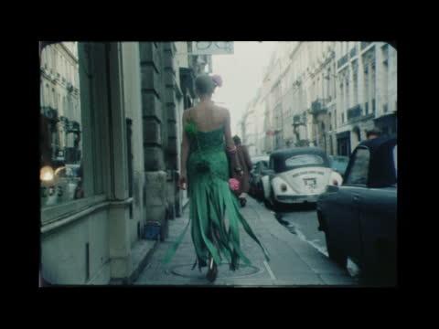 paris fashions; b) naf remains france: paris: buyer tilt paper evening dress in street turns and walks ribboned skirt ekt 16mm botras/hedelle 20 secs... - anna ford stock videos & royalty-free footage