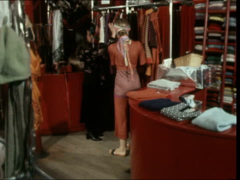 paris ms trouser suit up steps rl bv ditto across zebra crossing ms ditto rl into shop bv up to rail takes off dress jacobson up to her ms dress wrap... - wrap dress stock videos and b-roll footage