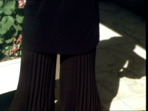 yves saint laurent; france: paris: st laurent salon: ext cms tilt down see-through blouse and knickerbockers to boots: feet turn round col ekt: 16mm:... - bloomers stock videos & royalty-free footage