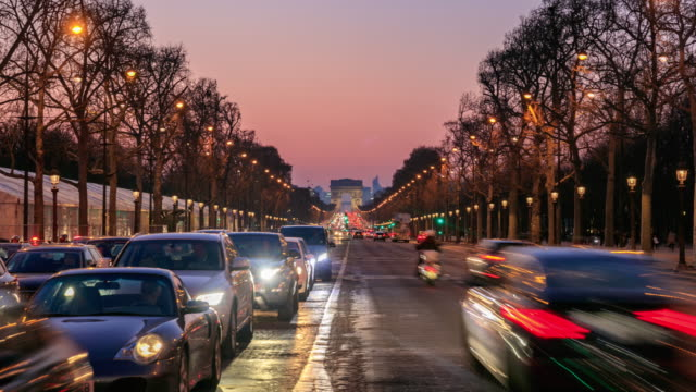Paris, France, Arch of triumph and Champs Elysees at sunset, time-lapse