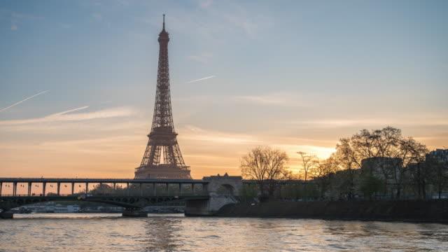 paris france time lapse 4k, city skyline sunrise timelapse at eiffel tower and seine river bir-hakeim bridge - eiffel tower paris stock videos & royalty-free footage