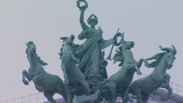paris, francestatue of apollo with four horses - statue stock videos & royalty-free footage