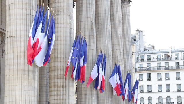 Paris, french and european flags in the street