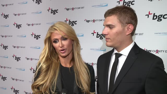 interview – paris hilton and chris zylka on the charity they support today at annual charity day 2017 hosted by cantor fitzgerald bgc on september 11... - paris hilton stock videos & royalty-free footage