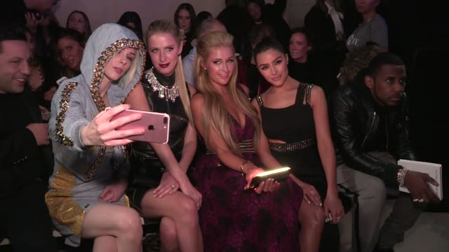 Paris Hilton and Nicky Hilton Olivia Culpo Coco Rocha NAS The Naked Cowboy and more at Philipp Plein Ready To Wear fall winter 2017 fashion show in...