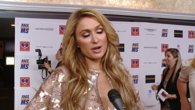 vídeos y material grabado en eventos de stock de interview paris hilton on being a longtime supporter of the event what she's most looking forward to at the 22nd annual race to erase ms in los... - paris hilton