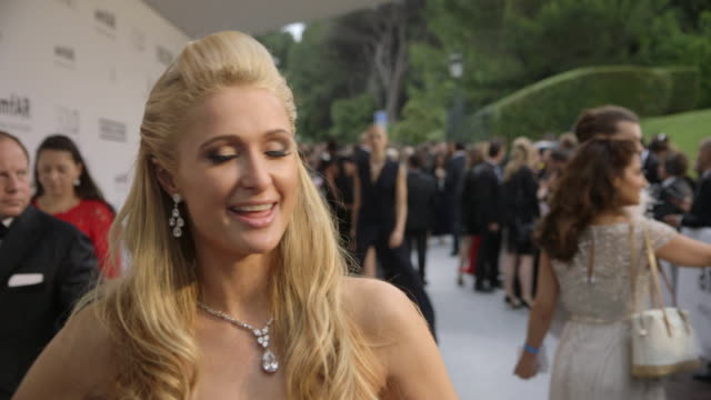 INTERVIEW Paris Hilton on being at AmfAR at AmfAR Red Carpet at Hotel du CapEdenRoc on May 22 2014 in Cap d'Antibes France