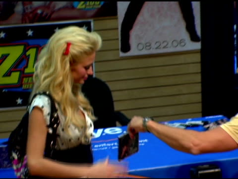 paris hilton poses with her new cd at the paris hilton cd signing at 51st street fye in new york new york on august 16 2006 - paris hilton stock videos & royalty-free footage