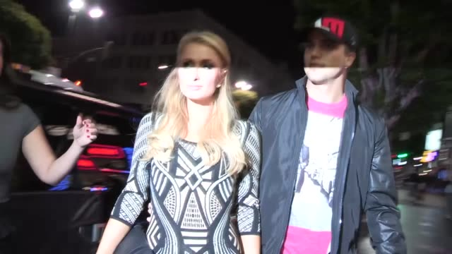 paris hilton river viiperi greet fans while arrriving at playhouse in hollywood 04/04/13 - playhouse stock videos and b-roll footage