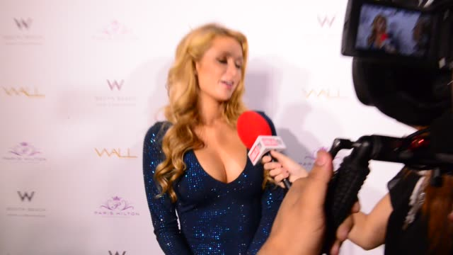 Paris Hilton walks the red carpet before DJing at Wall at W Hotel South Beach during Art Basel Miami Beach on December 5 2014 in Miami Beach Florida