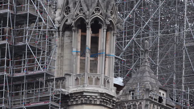 work on the notre-dame de paris cathedral begins to dismantle tons of metal scaffolding that melted during the april 2019 fire that destroyed the... - spire stock videos & royalty-free footage
