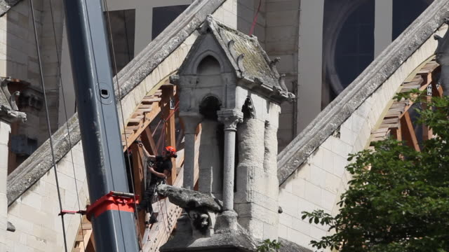 workers at notre-dame de paris cathedral begin to dismantle tons of metal scaffolding that melted during the april 2019 fire that destroyed the... - spire stock videos & royalty-free footage