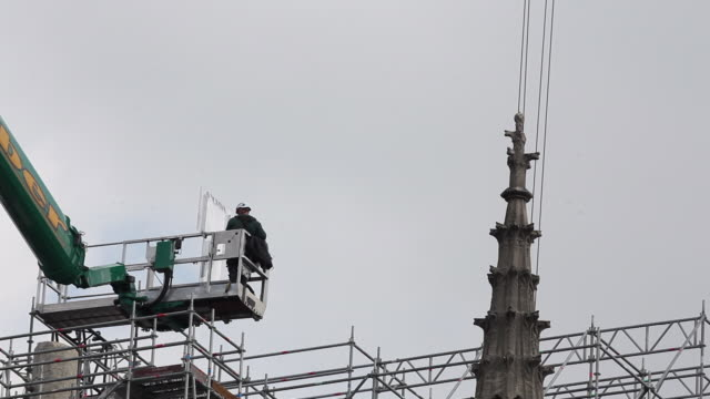 workers at notre-dame de paris cathedral begin to dismantle tons of metal scaffolding that melted during the april 2019 fire that destroyed the... - restoring stock videos & royalty-free footage