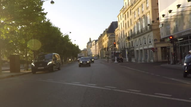 Paris Left Bank. Quai Voltaire. Rear Pov driving. Slow-Motion.