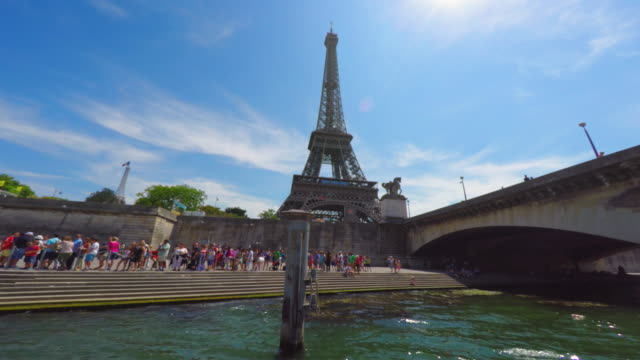 Paris left riverbank and Eiffel Tower seen from a boat on River Seine.