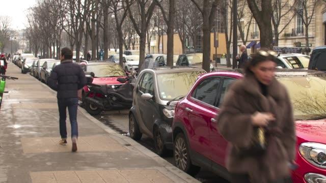 luxury shops on avenue montaigne / people along champs-elysees; france: paris: 8th arrondissement: avenue montaigne: ext fendi store / chanel store /... - salvatore ferragamo stock videos & royalty-free footage