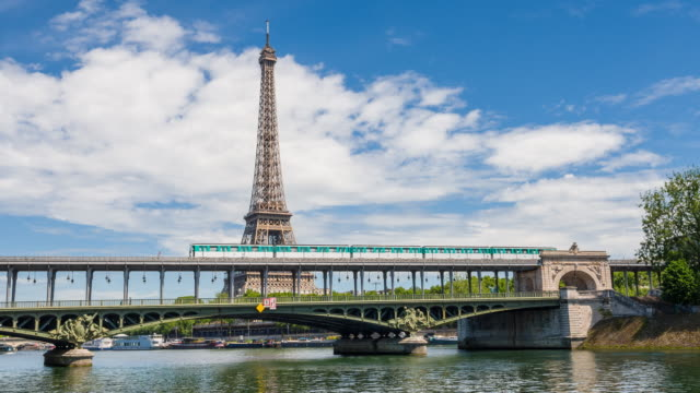 paris metro crossing the seine river on the pont de bir-hakeim with eiffel tower in background - viewpoint stock videos & royalty-free footage