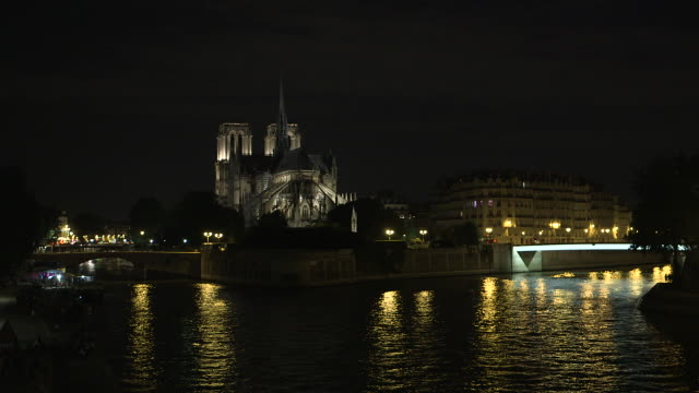 paris monument at night, notre dame cathedral, the seine, night lighting goes out - street light stock videos & royalty-free footage
