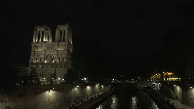 paris monument at night, notre dame cathedral, the seine - river seine stock videos & royalty-free footage