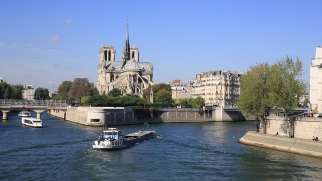 Paris, Notre-Dame, boats on the Seine river in the morning