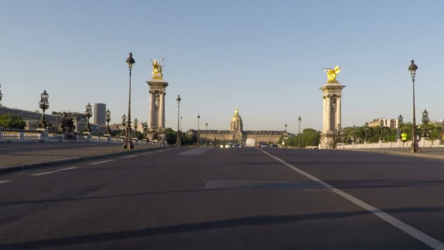 paris rear pov driving across pont alexandre iii. slow-motion. - moving process plate stock videos and b-roll footage
