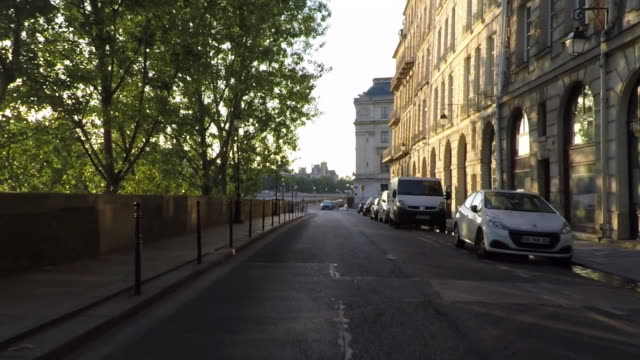 paris rear pov driving along quai de l'horloge. íle de la cité. slow-motion. - moving process plate stock videos and b-roll footage