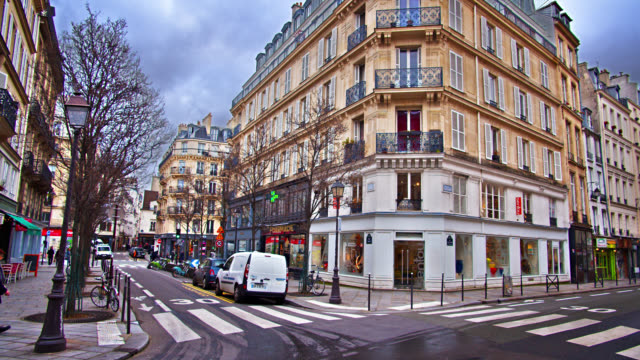 paris residential district intersection. trees and moody sky. city center. - history stock videos & royalty-free footage