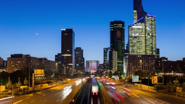 Paris road leading towards La Grand Arche and modern office buildings at La Defense, Paris, France - Time lapse