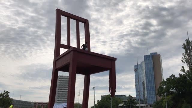 paris saint germain's brazilian player neymar shoots a ball from the monumental wood sculpture 'broken chair' during an event organized by the... - neymar da silva stock-videos und b-roll-filmmaterial