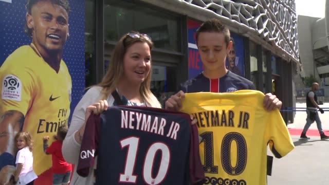 paris sg sells more than 10000 shirts bearing neymar's name and his new number no10 in just one day a day after the star player commits to five years... - neymar da silva stock-videos und b-roll-filmmaterial