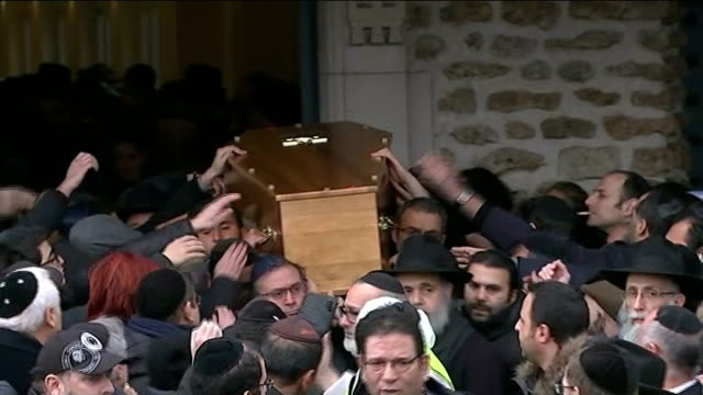 jewish residents reaction vox pop coffin being carried through crowd people reaching out to touch coffin people along behind hearse some touching... - carro funebre video stock e b–roll