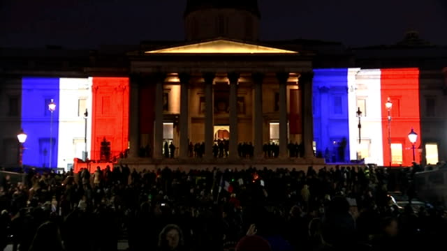 Unity rallies take place around the world ENGLAND London Tower Bridge lit up Red White and Blue to show solidarity with the people of France...