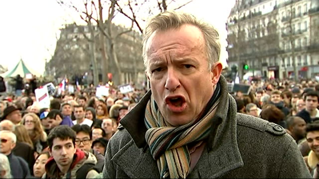 Paris shootings aftermath / World leaders join Unity march in Paris Reporter to camera SOT French tricolour flags held up amongst the crowd Large...