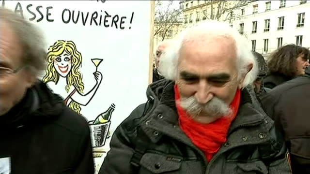 paris shootings aftermath / world leaders join unity march in paris; un-named man interview sot - asked what charb and the charlie hebdo cartoonists... - カトゥーニスト点の映像素材/bロール