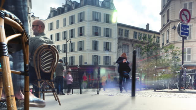 paris sidewalk cafe couple cinemagraph 4k - french culture stock videos & royalty-free footage