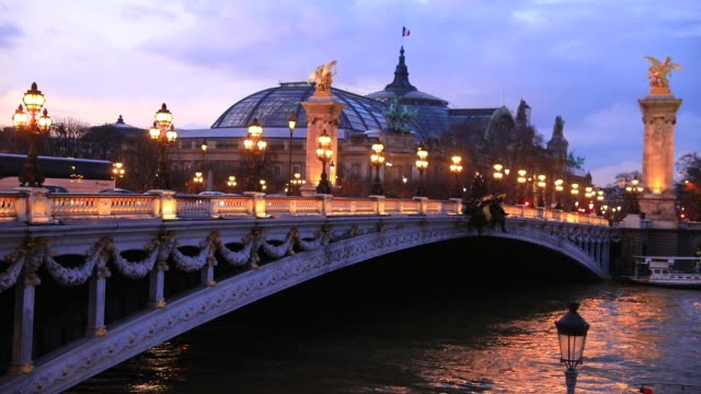 paris sightseeing at dusk on march 6 2020 in paris france image of the iconic pont alexandre iii at dusk the grand palais as background - pont alexandre iii stock videos & royalty-free footage