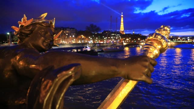 paris sightseeing at dusk on march 6 2020 in paris france statues on the iconic pont alexandre iii at dusk eiffel tower as background - pont alexandre iii stock videos & royalty-free footage