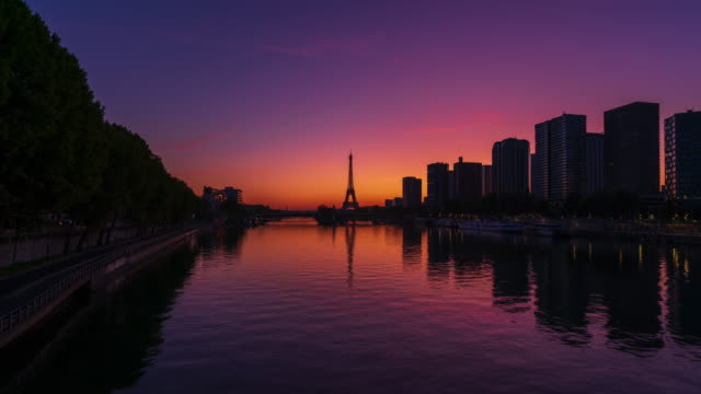 paris skyline, seine river, and eiffel tower with twilight sky- 4k time lapse from dawn to day - dawn to day stock videos & royalty-free footage