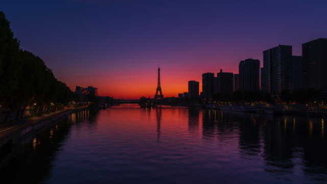 paris skyline, seine river, and eiffel tower with twilight sky- 4k time lapse from dawn to day, zoom-out - dawn to day stock videos & royalty-free footage