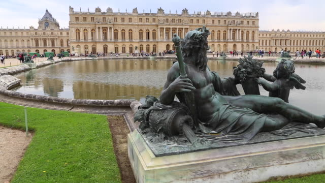 paris, statue in the gardens of the chateau de versallies - chateau de versailles stock videos and b-roll footage